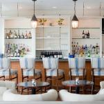 Enjoy light bites or your favorite cocktails and beverages in our lounge at The Dunes