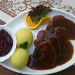 Sauerbraten with dumplings and red cabbage