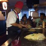 Chef serving fried rice, and cooking noodles