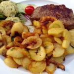 Angus-Rind mit hausgemachter Kräuterbutter und leckerer Bratkartoffel