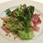 Green Salad with fruit, prosciutto, pistachios