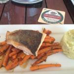 Yummy salmon with sweet potato chips.