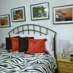 cozy bed with nature photos and bedside table