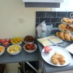 nice breakfast with fruits, baked goods and cold cuts