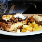 Steak sandwich with poached eggs