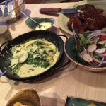 Rib eye steak with spinach salad & chips