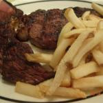 Medium cooked steak and French Fries.