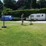 Adults & children making use of the campsite's outdoor facilities