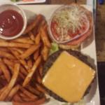 Black Bean Burger - Homemade Black bean burger topped with American cheese, lettuce, tomato, oni