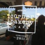 Corner Bakery Cafe - sign in front window