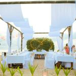 Tables on the beach for Paradise wedding