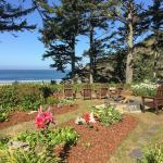 Tyee Lodge garden with fire pit and Adirondack chairs -- enchanting and relaxing!