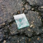 Drug baggie found in parking lot