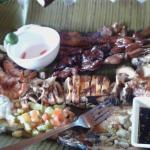Pork, chicken barbecue, grilled squid and daing na bangus with bagoong.