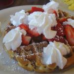 waffles with fresh strawberries and whipped cream