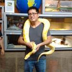 My brother holding the boa constrictor