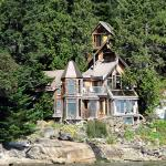 A West Coast retreat--nestled among trees by the sea.