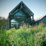 View of the Outdoor Campus building from the butterfly garden