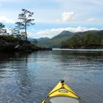 Kayaking among the islands of Loch Maree