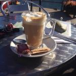 Morning coffee on quayside opposite the shop.