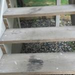 Dirty steps leading to room.