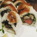 Grilled steak with steamed prawn sushi, drizzled in sweet onion sauce.