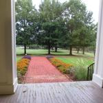 View of the grounds, looking past the front porch columns