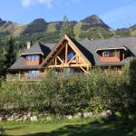 Summer Look of Vagabond Lodge with ski runs behind
