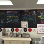 Take home cakes and pies. Yummy toppings. The board with flavor and menu.