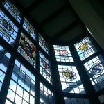 A selection of stained glass windows opposite the bar