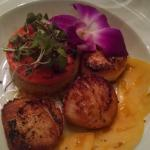 Pan seared sea scallops with maple cous cous and grilled papaya