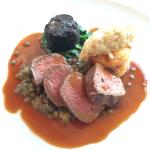 Loin of venison with beetroot dauphinoise, lentils, black pudding and wilted spinach