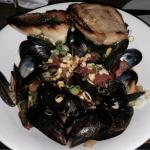PEI Mussels with Linguiça sausage, corn and tomatoes and a great broth to dip the crusty buttere
