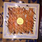 Carpaccio de saumon, réduction de balsamique et baies rouges