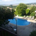 """Fotografía desde la terraza de """"habitación con vistas"""" (orientación a la piscina y al mar)"""
