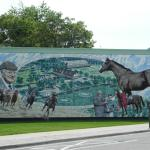 Mural of an old man and either his horse or a horse.