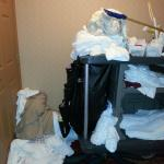 dirty linen and hkeeping cart left  in front of room for hours!