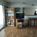 The shared living room area with lots of movies and books in the private room sectio.n