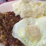 Eggs over Easy, Corned Beef Hash, Grits & Rye Toast