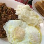 Eggs over Easy, Corned Beef Hash, Grits & Rye Toast