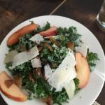Kale salad with peaches and cheese