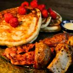 Hot pancakes with fruit and bacon