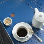 Coffee on awesome blue tables outside.