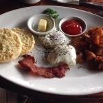 Breakfast deal- poached eggs and very crispy bacon. Also Includes tea or coffee and a juice.