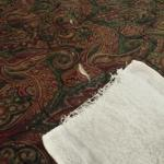 Tattered towel and torn bedspread at this hotel