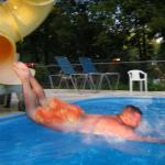 The pools got a slide, and this nut went down headfirst!