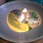 Duo of fish, (salmon and cod) cooked perfectly with a lobster sauce.