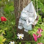 Tiny vsiting Gnome couple swings in the trees