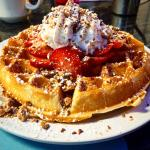 Strawberry Heath bar waffle with Hungarian eggs Benedict with house made Hungarian sausage (like