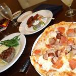 The Champ Pizza (pepperoni, mozzarella, pecan smoked sausage and onions)